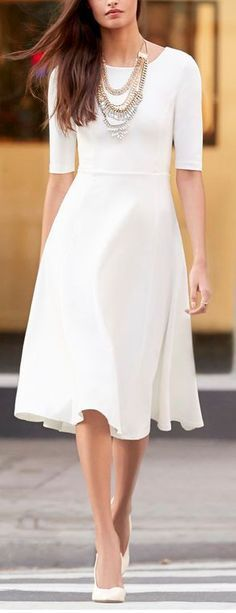 Fashion trends | Elegant white dress with statement necklaces
