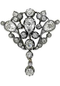 A late Victorian diamond brooch/pendant Of overall pear-shape form, pierced and set throughout with old pear and old round brilliant-cut diamonds, with detachable brooch fitting, mounted in silver on gold, length 32mm, pendant bale lacking, the three old pear-cut diamonds estimated to weigh approximately 1.30cts in total, the remaining diamonds estimated to weigh approximately 0.65ct in total