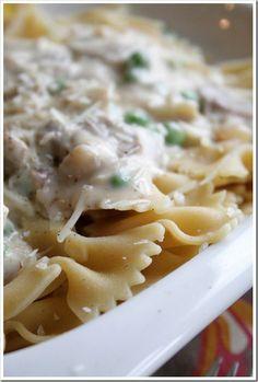 Pasta with (wait for it...) TRUFFLE OIL, Parmesan cream sauce, onions, mushrooms. Mmmmm ( I'll probably add spinach instead of peas--kids won't eat em). Yum yum YUMMMMY yum yum