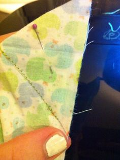 "Observe closely in the photo: do not stitch to the edge. You must leave 1/4"" or 1/2"" at the bottom of the fabric untouched.  This is the most important step in creating a nice hidden corner."