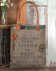 0e0921ef70 Atelier de Paris Tote Bag has drop handles and other elements in soft  leather. This