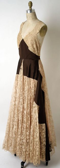 Dress, Evening  House of Paquin  (French, 1891–1956)    Date:      spring/summer 1939  Culture:      French  Medium:      silk, cotton  Dimensions:      [no dimensions available]  Credit Line:      Gift of Mrs. Harrison Williams, Lady Mendl, and Mrs. Ector Munn, 1946  ~MMA online