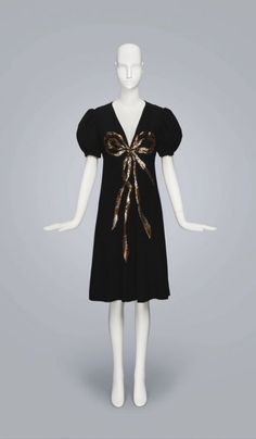 Dress; Designer: Yves Saint Laurent; Spring-Summer 1971; Silk Crepe Embroidered With Gold And Silver Sequins; Costume and Textile Arts; 2016.35.38, From the collection of Ruth Quigley, Fine Arts Museums of San Francisco