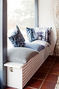 We love how this radiator cover has doubled up into a cosy window seat! We love how this radiator cover has doubled up into a cosy window seat! Radiator Shelf, Radiator Ideas, Kitchen Radiator, Modern Radiator Cover, Home Radiators, Heating Radiators, Home And Living, Living Room, Living Area
