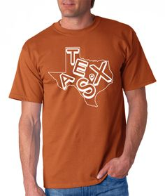 Imagine moseying into your local watering hole on game day wearing this bad boy tucked into your well-worn wranglers. There's little doubt that fiery filly behind the bar will be confused about who you are and what you're all about –– a longhorn fan through-and-through.  When you wear the Austin Edition of our Texas T-Shirt, printed on either iconic Texas Orange or bold White, you'll show you've got true Texas style — all that's missing are your hands in the air flying the Hook 'em Horns.