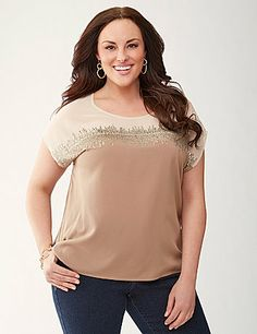 Dazzling sequins dance across our silky tee, making this modern favorite a must-have for your wardrobe. Pieced with sheer illusion paneling at the bodice and a trimmed keyhole detail in back for a touch of spice, this glitzy top dresses up or down beautifully and shows off your figure with short sleeves and a scoop neckline. lanebryant.com