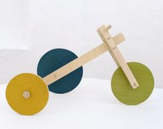 Wooden toy kids puzzle, eco friendly toy - The Asymmetricycle Design Toy.