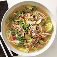 PORK AND GINGER NOODLE SOUP   8 ounces rice noodles  1 quart beef broth  1 inch fresh ginger, sliced  2 cups Pulled Pork  6 baby bok choy, sliced crosswise  1 1/2 cups mung bean sprouts  1/4 cup sliced scallions  1/2 cup cilantro sprigs  8 lime wedges  Hot chili oil