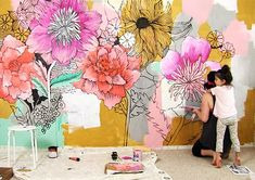 Two years ago I decided to paint a giant black and white flower mural on our bedroom wall. It was a really fun project and a SUPER cheap way to transform our bedroom (and our co-sleeping arrangement)