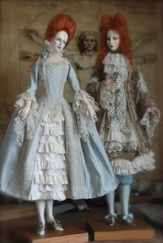Dolls, made of wood. Height about 65 cm. Suit silk and antique lace.