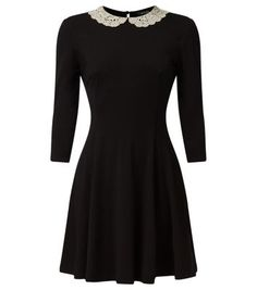 Give this crochet collar swing dress an edgier spin with heeled pointed ankle boots, for an everyday style.- Crochet collar- 1/2 sleeves- Gathered design- Stretch jersey fabric- Keyhole back- Dress length: 35