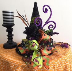 Witch Centerpiece - Witch Hat Floral Arrangement - Witch Hat Centerpiece - Halloween Centerpiece - Halloween Decor - Halloween Decoration by DecoDecorByPatina on Etsy https://www.etsy.com/listing/465445393/witch-centerpiece-witch-hat-floral