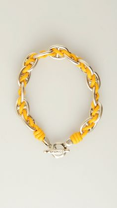 ANDREA D'AMICO marine chain bracelet featuring yellow waxed cotto detail, toggle clasp.