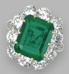 Emerald and diamond ring, Van Cleef & Arpels, New York. The emerald-cut emerald weighing 6.83 carats, framed by round diamonds weighing approximately 4.10 carats.