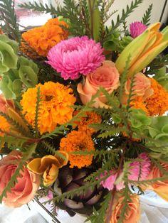 Fun fall arrangement, oranges,pink and artichokes!