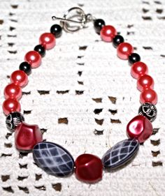 This hot hot hot pink and black bracelet makes a bold statement. It's gorgeous and you want everyone to see it!