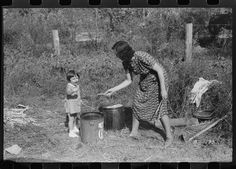 """Mountaineer's daughter and her mother enjoying the sorghum syrup at a neighbor's home during a """"syrupping off,"""" Breathitt County, KY, 1940. Library of Congress."""