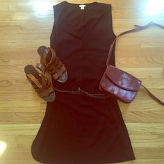 NWOT J.crew black sleeveless shift dress Light button down shift dress. Pocket on left side of chest. Can wear in the summer with a belt and sandals or with boots, tights, and a big sweater in the winter. 100% polyester. J. Crew Dresses Mini