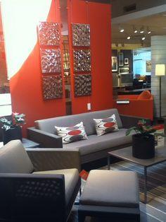 Grey and Orange livingroom at Crate & Barrel