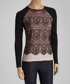 Sporting a feminine lace overlay, this sweater makes one stylish wardrobe boost. Solid black long sleeves create a perfect contrast while keeping arms toasty.