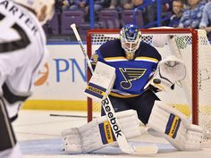 St. Louis Blues goalie Jake Allen makes a save on a shot taken by Los Angeles Kings center Jeff Carter during the first period in St. Louis. The Kings shutout the Blues 3-0.  Jasen Vinlove, USA TODAY Sports