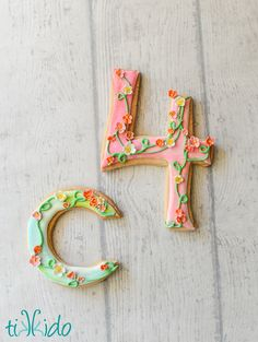 Sugar cookies decorated with flowers and vines for an American Girl's Wellie Wishers themed birthday party.