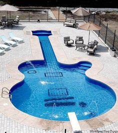 """naglly:  ギター型のプール。泳ぎづらそう。 (via Guitar-Shaped Swimming Pool - Imgur)  """