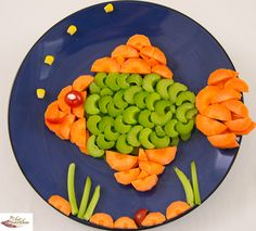 Salad Fish Carrots, snow peas (or green peas) ,corn kernels, celery sticks and cherry tomato.