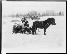 1909: Taking a sleigh ride.