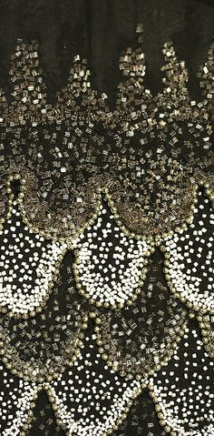 Vermicelli tambour beadwork on a ca. 1926 silk evening dress. Learn how to embroider to fashion industry standard from experts who work for Chanel, Louis Vuitton and more at https://www.mastered.com/course-listings/3
