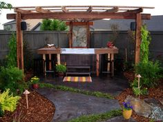 This gorgeous hot tub entertainment hub comes complete with a colorful stamped concrete patio, inviting U-shaped bar, slate mosaic wall and beautiful, shady arbor.