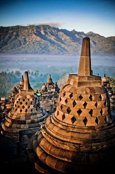 Candi Borobudur (Borobudur Temple) is the single most-visited tourist attraction in Java, Indonesia, and the largest Buddhist monument in the world. Built ca. Places Around The World, Oh The Places You'll Go, Places To Travel, Around The Worlds, Bali Lombok, Temples, Laos, Borobudur Temple, Voyage Bali
