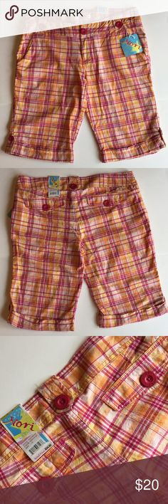Nori shorts pretty, comfy plaid  Nori shorts in longer cuffed style with cute pink Nori buttons. Front side pockets. Back pockets are just for looks and accent. New with Tags. Size 13. Colors - pink, orange, yellow. Measurements - waist 18 inches, hips 21 1/2, inseam 13 1/4, front rise 9 1/2, leg opening 10 1/2, length from button loop to bottom leg hem 22 inches. Light weight cotton fabric - no stretch. Nori Shorts