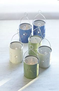 DIY Tin Can Lanterns - Recycle tin cans to make beautiful lanterns. (spray paint flowers tin cans) Recycled Tin Cans, Recycled Crafts, Recycled Tires, Recycled Clothing, Recycled Fashion, Handmade Crafts, Handmade Rugs, Craft Room Storage, Vintage Shelving