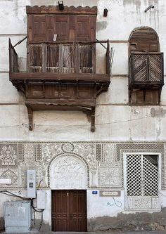 Similar to My grandfather shutters...love love the design the gypsum work below ..memories .. Old house in Jeddah - Saudi Arabia