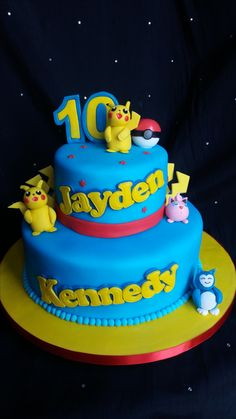 Pokemon 2 Tier cake with edible pokemon characters, Pikachu, Jigglyputt and Snorlax