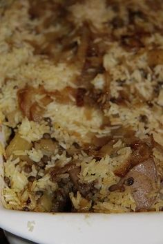Chicken Biryani with rice and lentils