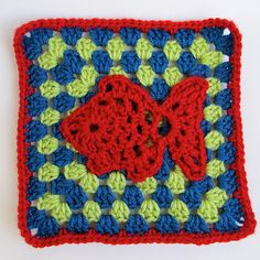 Make a granny square (with ch 2 corners and no chain in between the dc groups) and sew the fish motif onto it with thread.  For the fish I used the pattern Goldfish Motif by Chinama Horiba which can be found on Ravelry.