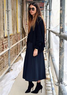 oversize sweater and pleated skirt