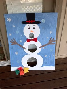 How it was made: I got a foam board, then used bowls and cups to outline the body of the snowman, I painted the background blue and cut out the holes with a knife, I used some soft paper for the bows and hat, and I got snowflake stickers to decorate the board. Purpose: Game for a Christmas party at children's hospital for kids with disabilities Note: I bought everything at hobby lobby