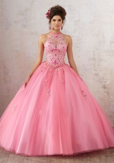 Look gorgeous in a Mori Lee Vizcaya Quinceanera Dress Style Number 89134 at your Sweet 15 party. Made out of tulle, this Quince dress features a high jeweled halter bodice decorated with beautifully f