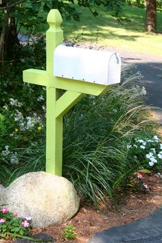 Cool idea for the mailbox post. Would complement an orange door perfectly!