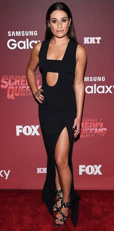 Lea Michele turned up the heat at the Scream Queens premiere in a racy David Koma black gown with a bandeau detail, a central cut-out, and a dangerously high slit. Slick strands and embellished black sandals completed her look.