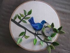 """A Beautiful embroidered hoop with a bird and music notes in a tree: """"One Groovy Stumpwork Bird"""".... this kind of work makes me want to give this craft a try :)"""