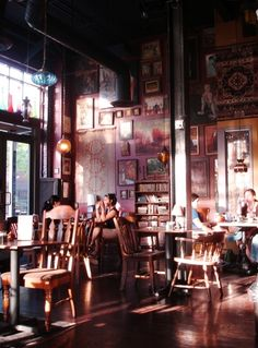 Boho coffee shop? love it. This is what my shop would look like. and.. of course it would have a fireplace area with the moroccan ottomans scattered around. there would be room in that area for open mike nite and all the chairs would be more comfortable and eclectic.