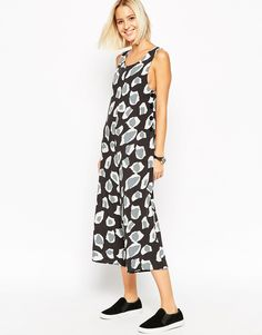 Image 1 ofASOS Button Side Jumpsuit in Animal Print