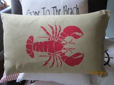 Beach themed throw pillow with stenciled lobster by JustTwoPeople. Stencil from Cutting Edge Stencils. http://www.cuttingedgestencils.com/lobster-stencil-beach-style-decor.html