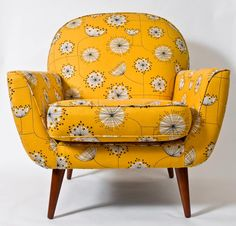 Furniture: This retro arm chair is bright yellow, and has floral designs printed on it. The chair's legs are thin, and have a dark stain. This chair has a curvy look to it with the rounded backrest, and armrests curved up. Home Furniture, Furniture Design, Furniture Upholstery, Modern Furniture, Repurposed Furniture, Antique Furniture, Bedroom Furniture, Furniture Ideas, Patterned Chair