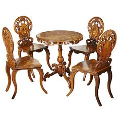 Complete Set of Antique Inlaid Edelweiss Brienz Tilt–Top Table and Four Chairs | From a unique collection of antique and modern tables at https://www.1stdibs.com/furniture/tables/tables/