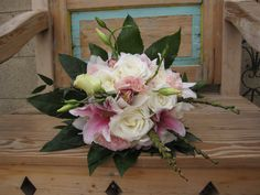 Bridal bouquet of white roses, oriental lilies, white cymbidiums, pink mini cymbidiums, lisianthus and tropical foliages by Fleurt Floral Art (Chandler, AZ)